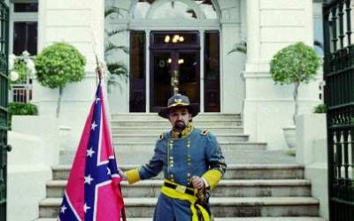 Civil War Confederate solder, flag and building