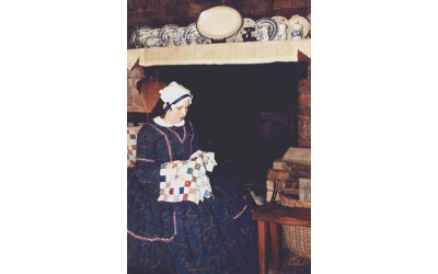 Colonial woman sewing
